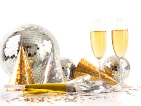 Champagne glasses with festive party hats