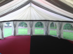 Hexagonal end marquee interior with red and black carpets and arch windows