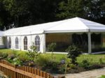 Hexagonal end marquee in garden