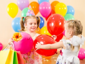 Children with balloons and gifts on birthday party