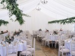 White linings with round tables and hanging ivy